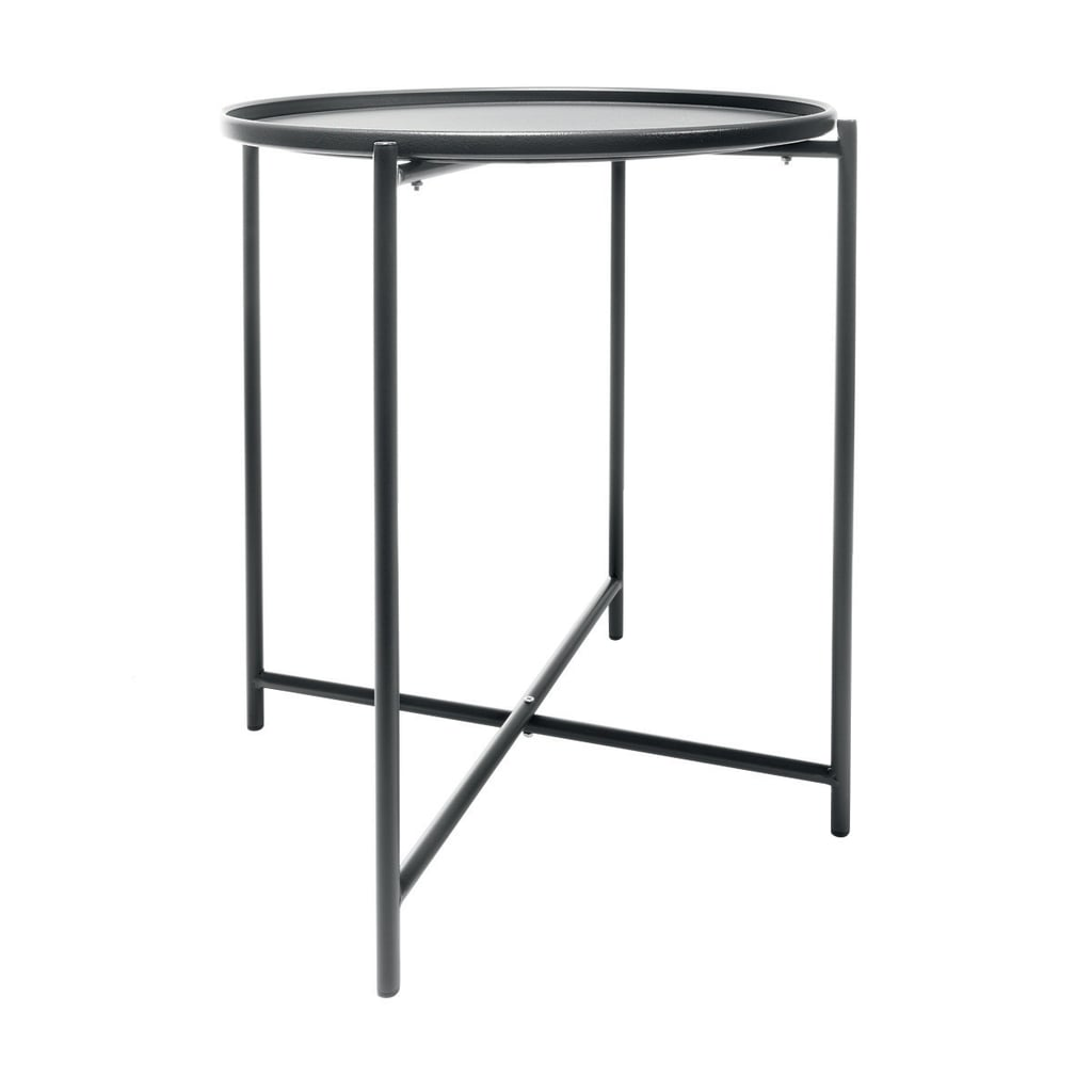 The top of this table is a a removable tray. So smart. Metal Tray Table ($15)