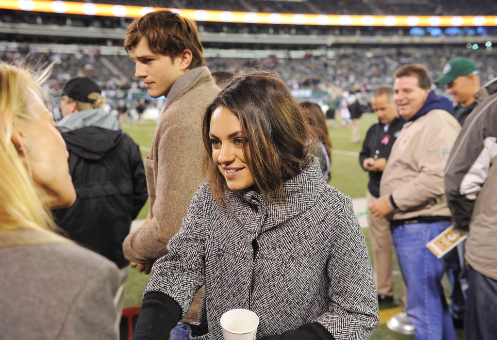 Mila Kunis and Ashton Kutcher hung out on the field at Met Life Stadium in New Jersey on Monday. The couple chatted with friends before watching the Houston Texans take on the New York Jets. Also on hand to witness the Texans win was Kevin James. Mila and Ashton got out of NYC for the game after hanging out there for the last few weeks while Mila films The Angriest Man in Brooklyn. Mila and Ashton picked up gelato on Tuesday and have shared other sweet PDA-filled dates when Mila's not in front of the cameras. They also had reason to celebrate when Mila was named Esquire's Sexiest Woman Alive for 2012.