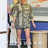 Kim Kardashian Beige Lace-Up Boots and Sweat Shorts