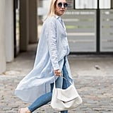 With a tunic top and mules