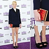 Michelle Williams followed suit (literally) on the menswear-inspired trend in this sweet navy-and-black Louis Vuitton short suit. For added quirk, she carried a Catcher in the Rye-cum-Olympia Le Tan clutch and wore patent leather bow-tie peep-toe pumps.