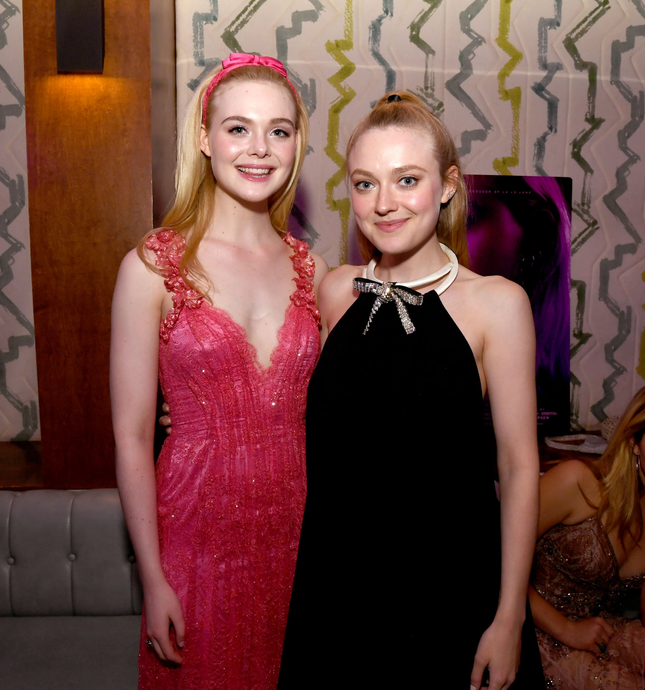 HOLLYWOOD, CALIFORNIA - APRIL 02: Elle Fanning (L) and Dakota Fanning pose at the after party for a special screening of Bleeker Street's