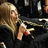 Cara showed off her Tequila socks backstage at Burberry Prorsum Spring 2014.