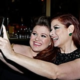 Pictured: Kelly Clarkson and Debra Messing