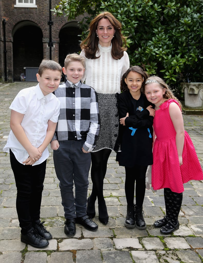 She posed with a group of children while launching the Huffington Post UK's Young Minds Matter initiative in February 2016.