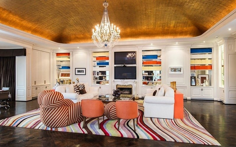 The vaulted gold ceiling is a dramatic touch in this casual sitting area.