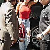 Ultradistressed denim became one of our staples after we spotted Selena wearing these pants (which feature a sexy cutout right above her thigh) with a bright red, low-cut one-piece swimsuit.