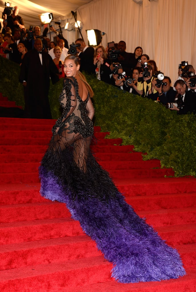 Beyoncé Knowles was one of the very last to arrive at the Met Gala in NYC tonight, but she still managed to make quite the entrance! Beyoncé's wore a sexy lace Givenchy gown that pooled into a long train of vivid blueish-purple feathers. Beyoncé's light blue pedicure peeked out from under her gown, so even though she was out on the town, B still kept Blue Ivy close to her heart. Beyoncé has been rocking the nail color since giving birth to her baby girl just a few months ago. Last year, Beyoncé needed some help from husband Jay-Z to get up the carpeted staircase in her tight Pucci number, while this evening she was joined by friend and Vogue's former editor at large, Andre Leon Talley. What do you think of her latest look? Vote on Fab and Bella's fashion and beauty polls, and be sure to check back for more photos from the Met!