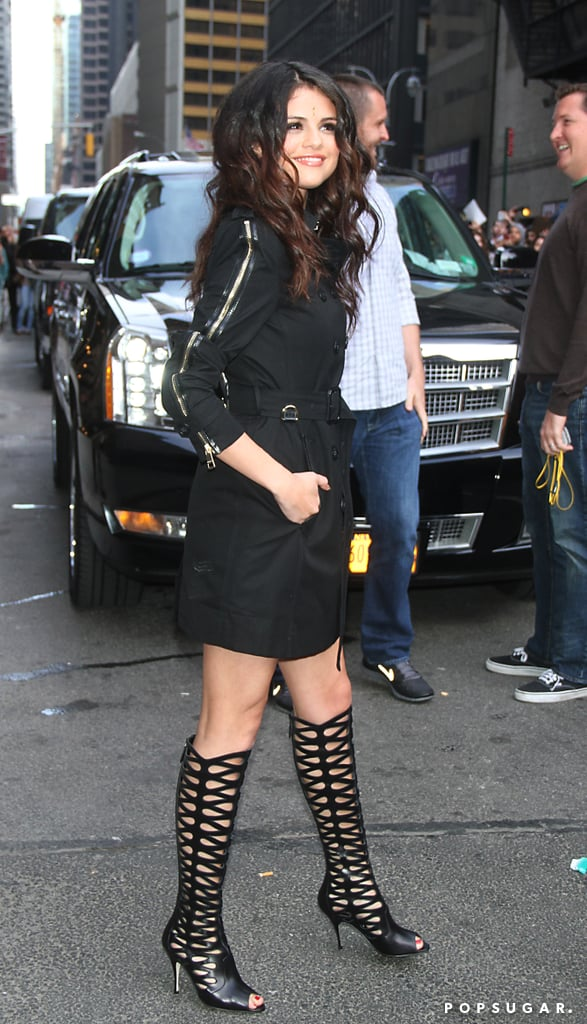 "Selena Gomez rocked a short black trench coat with sexy knee-high Brian Atwood boots while leaving the Late Show yesterday in NYC. Earlier in the day, Selena hit the stage for a live performance of her new single, ""Come & Get It,"" on the show. She first debuted the song at the MTV Movie Awards earlier this month, but drew criticism for donning a bindi, which is a traditional forehead decoration with religious significance in Hinduism. It seems the negative feedback did not affect her, though, since she donned it again for her appearance yesterday. Selena may be wearing a bindi regularly since she is promoting her new music before setting out for her world tour, which kicks off in Vancouver on Aug. 14.  Yesterday was a busy day of promotions for Selena. Ahead of her talk show stop, she also visited Z100's Elvis Duran and the Morning Show, where she addressed recent rumors about rekindling her romance with ex Justin Bieber. Selena said, ""I'm in my 20s. I want to have fun. I want to enjoy my life and not have to worry about every single thing."""