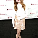 Isla Fisher mixed solids with prints, then finished off with coordinating Casadei nude platform pumps at CinemaCon in Las Vegas.