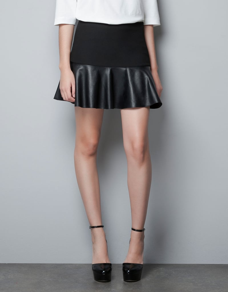 Pair this flippy leather skirt with a white shirt for a crisp color contrast.  Zara Miniskirt With Leather Frill ($90)
