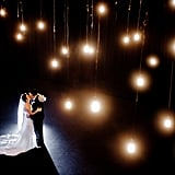 Speaking of lighting, for the couples who were really hoping for that outdoor and open-air reception, complete with bistro lighting, there's no reason not to string up lights inside as well. With bistro lights and market lighting becoming so popular, almost every rental company is offering them, and as long as your venue allows them, you should consider stringing them inside of your venue.