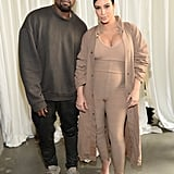 When Kim showed off her baby bump in a beige jumpsuit, but Kanye kept covered in a oversize sweatshirt.