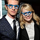 Emma Stone and boyfriend Andrew Garfield sported silly glasses during a charity event in June 2012.
