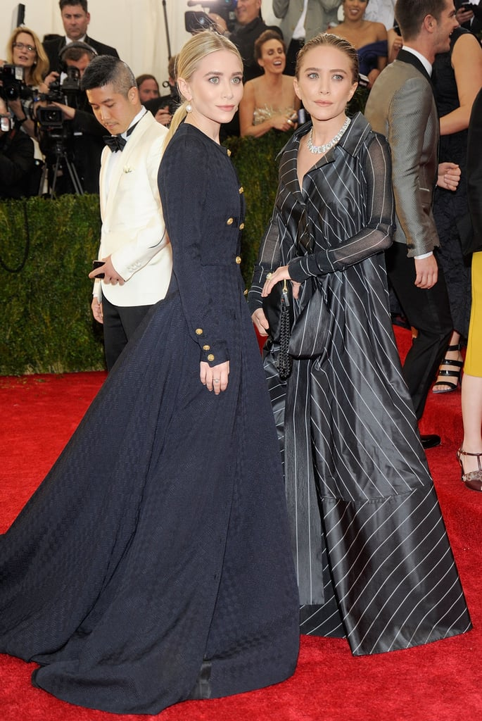 Twinning combo: At the 2014 Met Gala, the Olsens went vintage and voluminous.  Ashley donned a military-inspired Gianfranco Ferré featuring a luxe jacquard texture. Mary-Kate floated down the famous steps in striped Chanel.