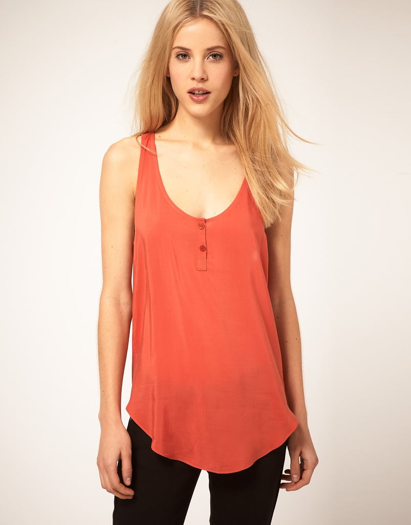 We love the flowy front and bright orange color — whether you wear this sheer tank with shorts or your favorite pair of jeans, it'll instantly liven up the outfit. ASOS Woven Button Front Tank ($29, originally $36)