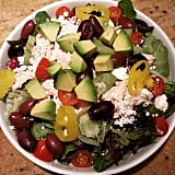 Salad with chicken, feta, pepperoncini, avocado, tomatoes, and kalamata olives.