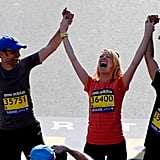 Boston Marathon bombing survivor Adrianne Haslet-Davis celebrated as she crossed the finish line one year later.