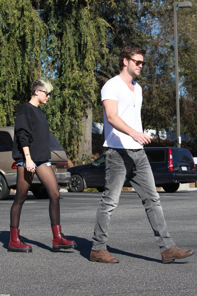 Miley Cyrus wore red boots for an outing with Liam Hemsworth in LA.