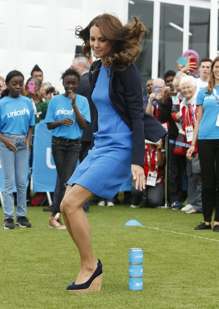 The Duke and Duchess of Cambridge were joined by Prince Harry on Tuesday for another round of events at the Commonwealth Games. Kate wore a blue dress for the occasion and showed off her sporty side with a hopping game. The trio first popped up in the stands on Monday, when they checked out something on Kate's phone, met up with Prince Edward, and Kate showed playful PDA with William. Their visit echoes back to the time that the royals were familiar faces in the stands at the London Olympics in 2012. They're hardly the first royals to visit the Commonwealth Games this year. Queen Elizabeth II took part in a now infamous photobomb last Thursday when she attended an event at the Games. There were no reports of Kate, William, or Harry photobombing members of the public during their stop, although William and Harry did get in on the selfie craze earlier this month when they took their first ever selfie in Buckingham Palace. Kate, we're still waiting for your selfie! The group will be together again next week to continue with their royal work. On Monday, they will travel to Belgium for a short trip to commemorate the 100th anniversary of World War I. Kate and William will be received by King Philippe and Queen Mathilde during their visit, and all of them will make memorial stops to honour those who lost their lives. On Tuesday, the group will be back in London to oversee a poppy installation at the Tower of London's moat for another memorial to World War I.