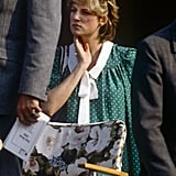 Unlike Kate Middleton, who opted for a dress that hugged her curves after giving birth to Louis, Diana stuck with loose-fitting options. She kept it casual with a lightweight green maternity dress complete with a white collar. She paired the dress with a pair of sunglasses and stud earrings.