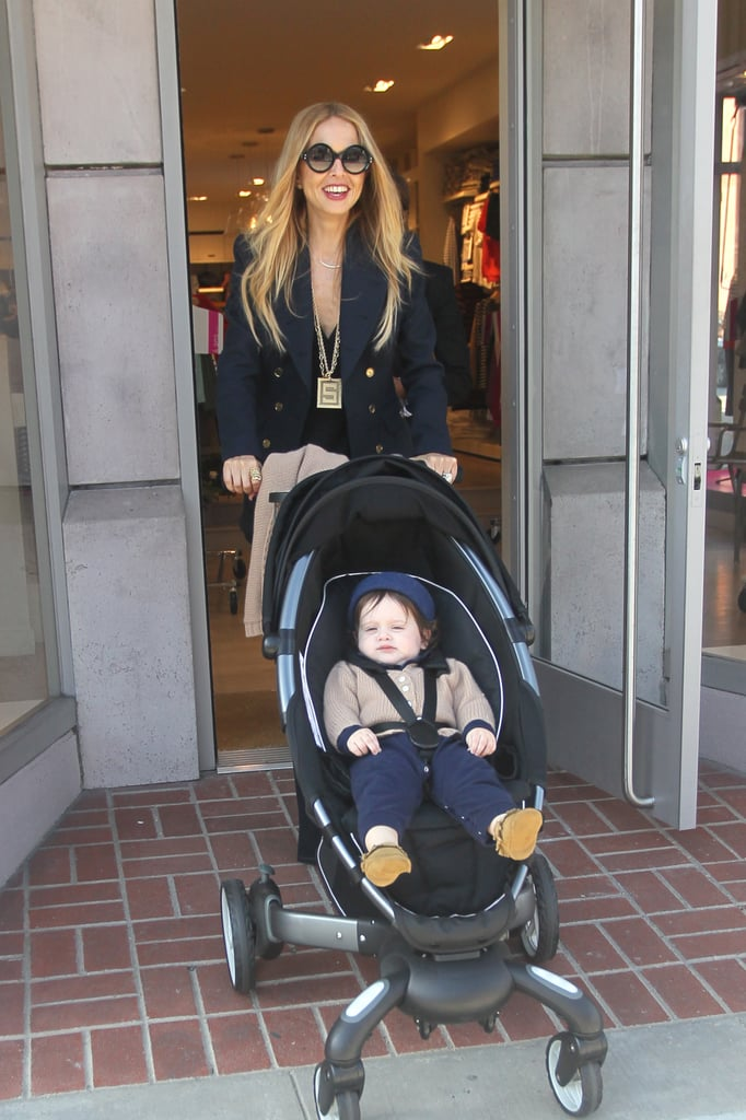Rachel Zoe had her son, Skyler Berman, along for a Beverly Hills shopping trip yesterday. The mother and son were seen scoping out kids' clothes as they browsed with Skyler's nanny. Rachel looked chic for the outing in a navy blazer and tunic top as she toted her handbag by The Row. Skyler may still be a tot, but he is already following in his superstylist mom's fashionable footsteps. Shortly after he was born, Rachel shared a peek at his already-impressive wardrobe, full of gifts from designer friends like Dolce & Gabbana. Rachel is back home in LA after spending some time at NYFW last month to attend several shows, including her own. Rachel unveiled her latest self-titled collection during the fashionable festivities, and the trip was a family affair. Rachel frequently toted Skyler on her hip to and from her hotel and teamed up with husband Rodger Berman backstage at her friends' presentations.