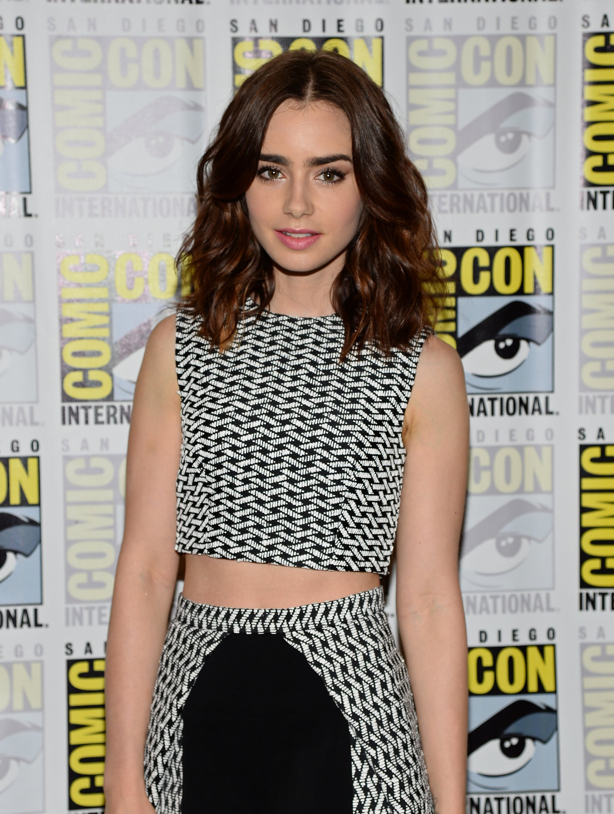 Lily Collins paired her wavy lob with her signature bold brows while at the press line for The Mortal Instruments: City of Bones.