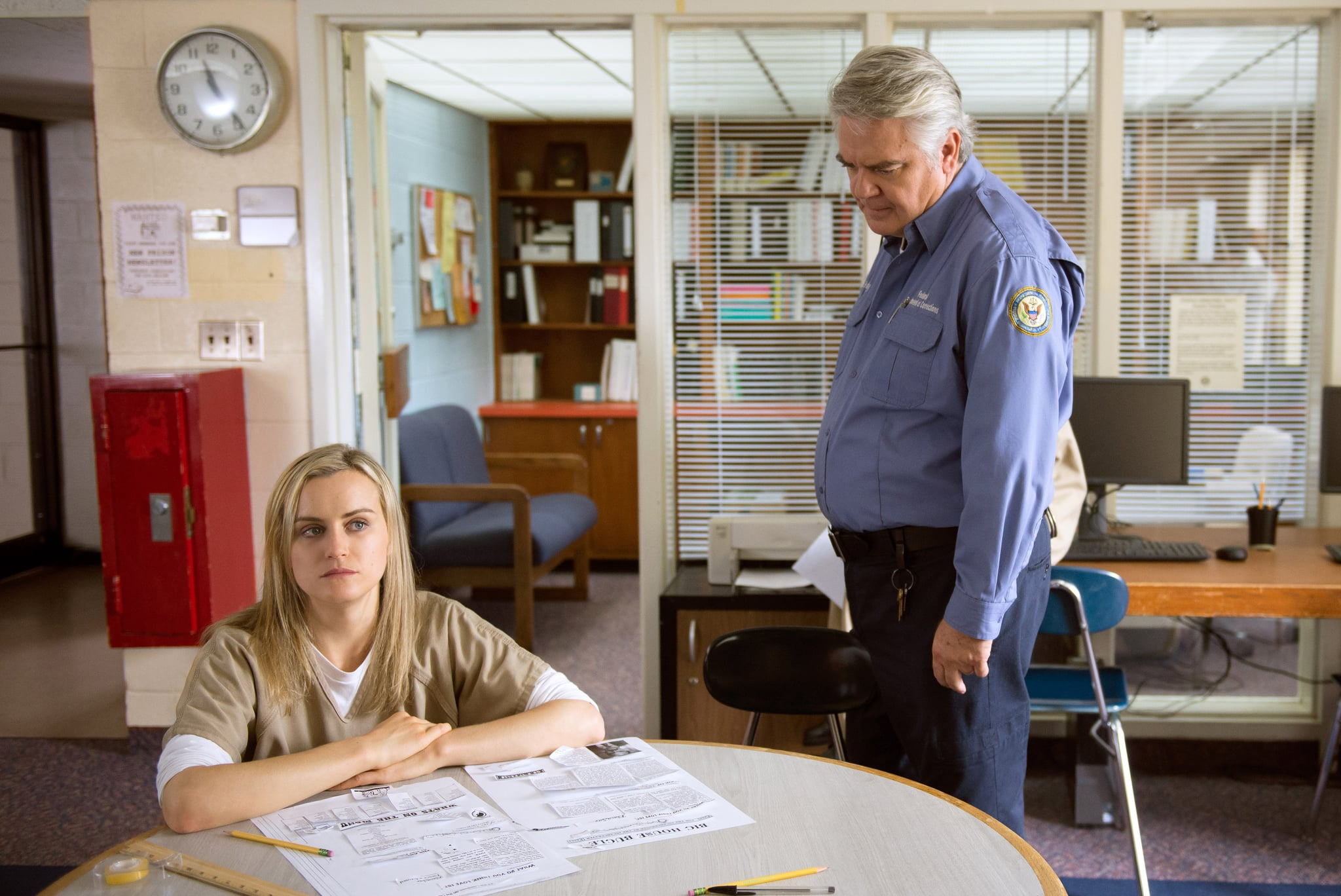 ORANGE IS THE NEW BLACK, (from left): Taylor Schilling, Michael Harney, (Season 2, aired June 6, 2014). photo: Ali Goldstein / Netflix / courtesy Everett Collection