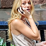 Blake Lively chatted on her cell phone while filming a scene for Gossip Girl.