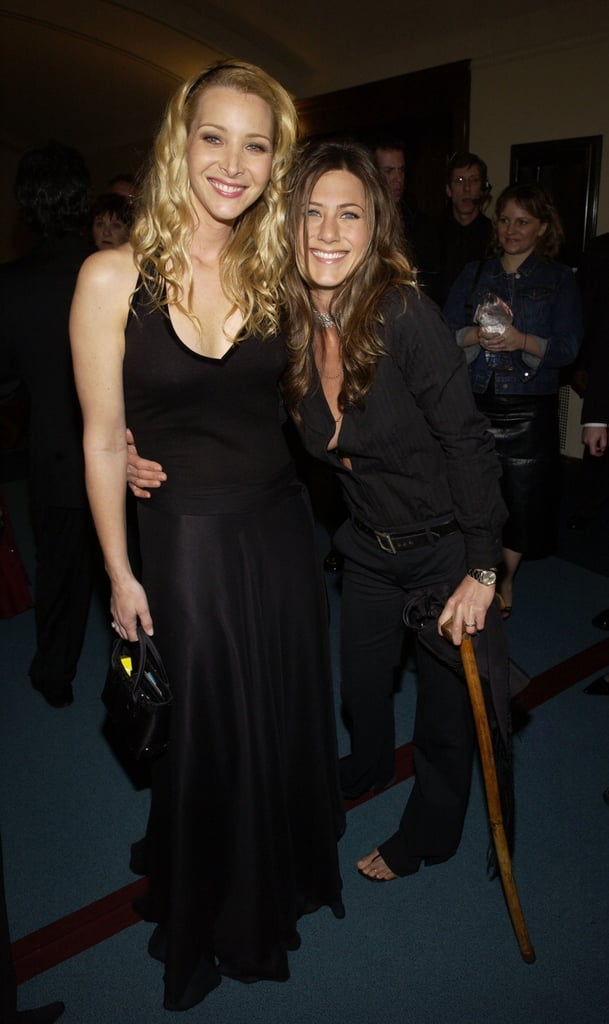 Jennifer Aniston leaned on a cane while posing backstage with Friends co-star Lisa Kudrow in 2003.