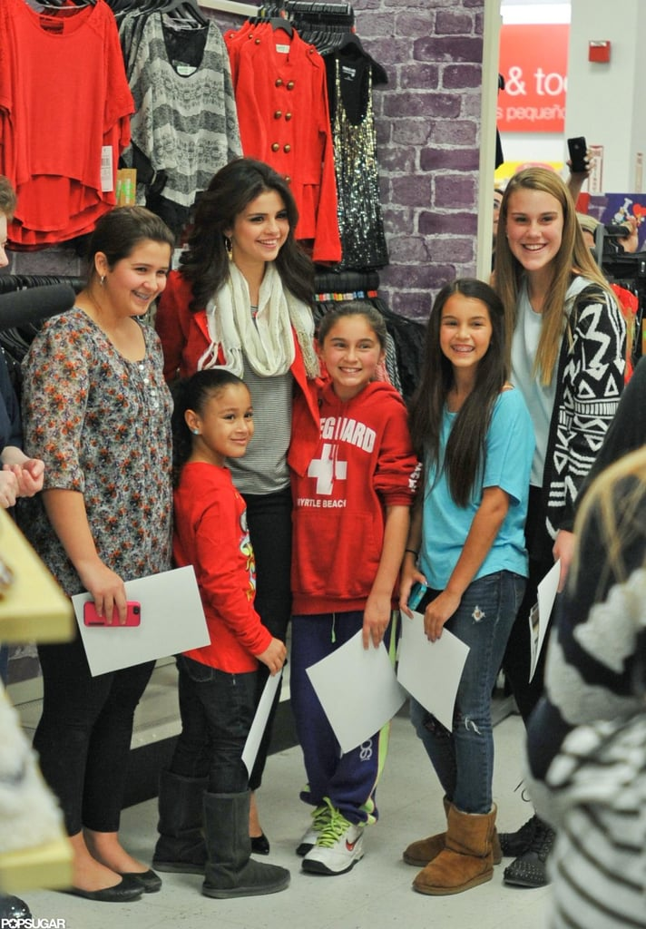 Selena Gomez posed with fans.