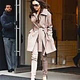 Victoria stepped out in a tailored suit that featured an oversize belted jacket and skinny pants.