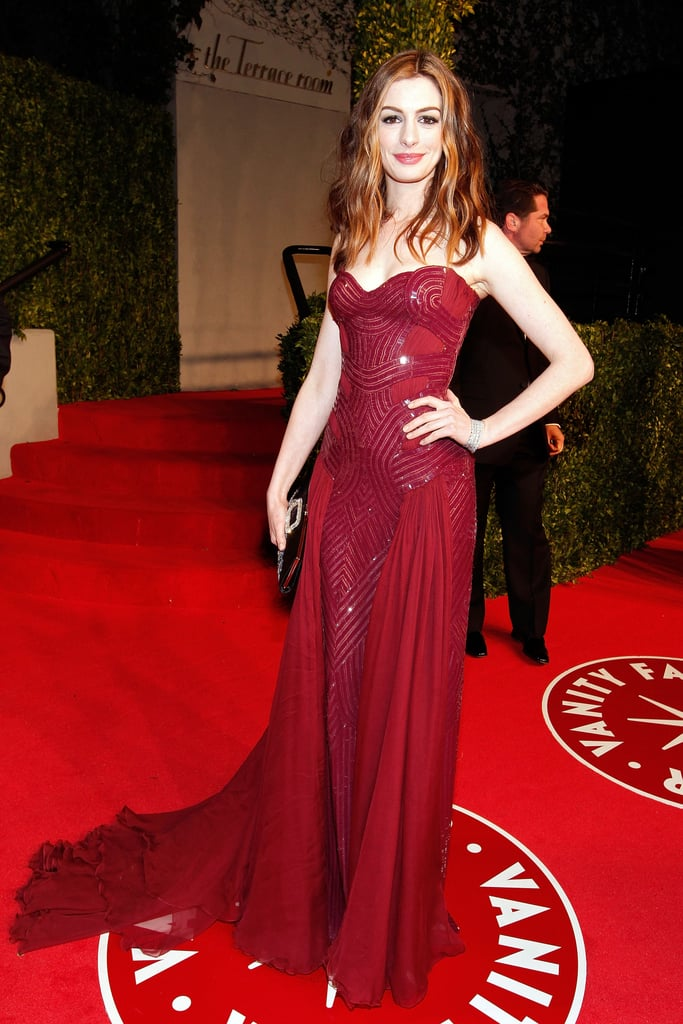 A vision in red Atelier Versace at the 2011 Vanity Fair Oscar party.