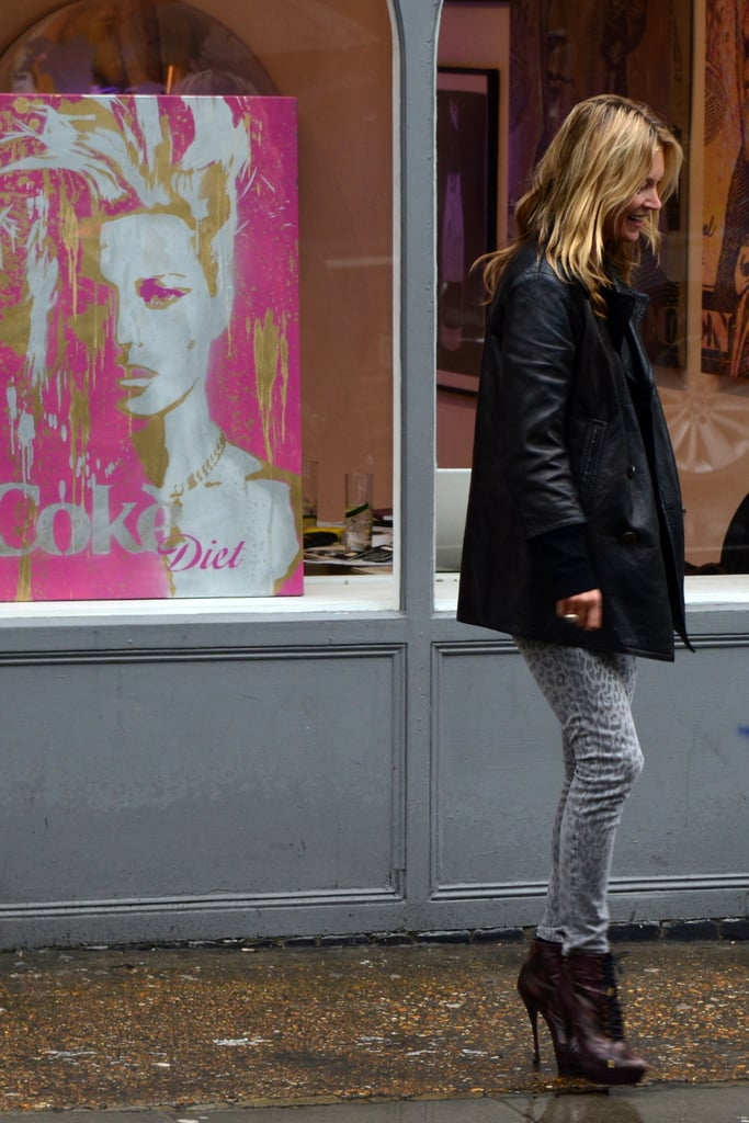 Kate Moss laughed about a painting of herself.