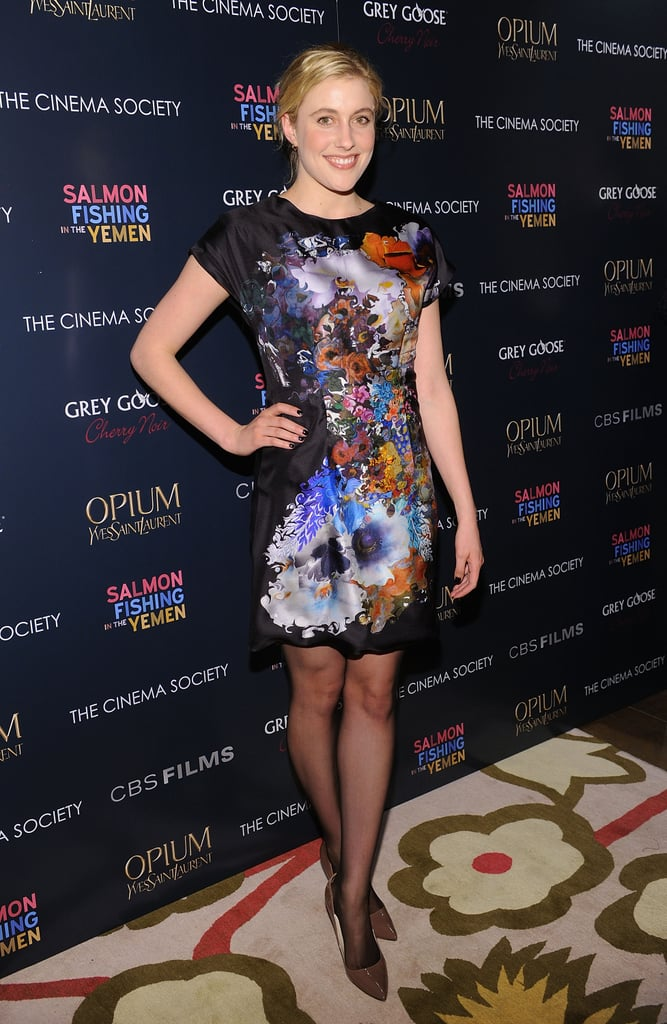 In March 2012, Greta got in on the floral trend via a black silky floral frock, which she paired with sheer black tights and brown pumps.  6855792