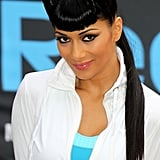 Even when wearing sportswear, Nicole doesn't skip the full-on face of makeup and perfectly styled hair. That retro fringe got another outing for an event with Reebok in 2010.