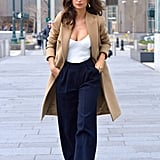 Play right into classic vibe with a camel coat and understated top like Emily Ratajkowski.