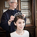 """Angelababy tried on her Chaumet tiara. Chaumet 'grammed this photo with the caption, """"Madame Beatrice de Plinval, curator of the Chaumet museum, thoroughly explained the history and jewels of Chaumet and personally selected the antique tiara and necklace for Angelababy to wear on her wedding."""""""