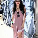 Vanessa Hudgens got in touch with her more tribal side with this asymmetrical-hemmed maxi dress, cowboy boots, and a feathered headdress.
