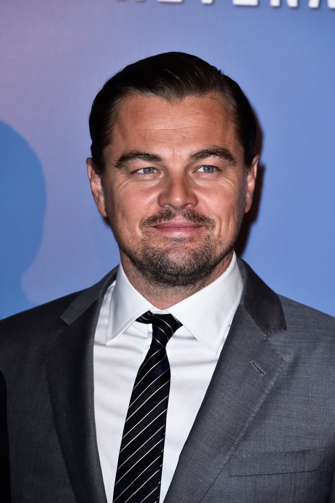Leonardo DiCaprio continued his press tour for The Revenant on Monday at Le Grand Rex in Paris. The actor, who is up for an Oscar this year, showed off his sexy smoulder on the red carpet before linking up with his costar Will Poulter and director Alejandro González Iñárritu. It's just the latest in a string of appearances the star has made these past few weeks, including a hilarious stop on The Ellen DeGeneres Show. Last week, all eyes were on Leo when he stepped out at the Golden Globe Awards and met up with his former Titanic costar Kate Winslet. On top of their sweet reunion, Leo was caught making the most hilarious face at Lady Gaga during the award ceremony. Keep reading for more photos, and then check out how Lady Gaga reacted to that whole Golden Globes moment.