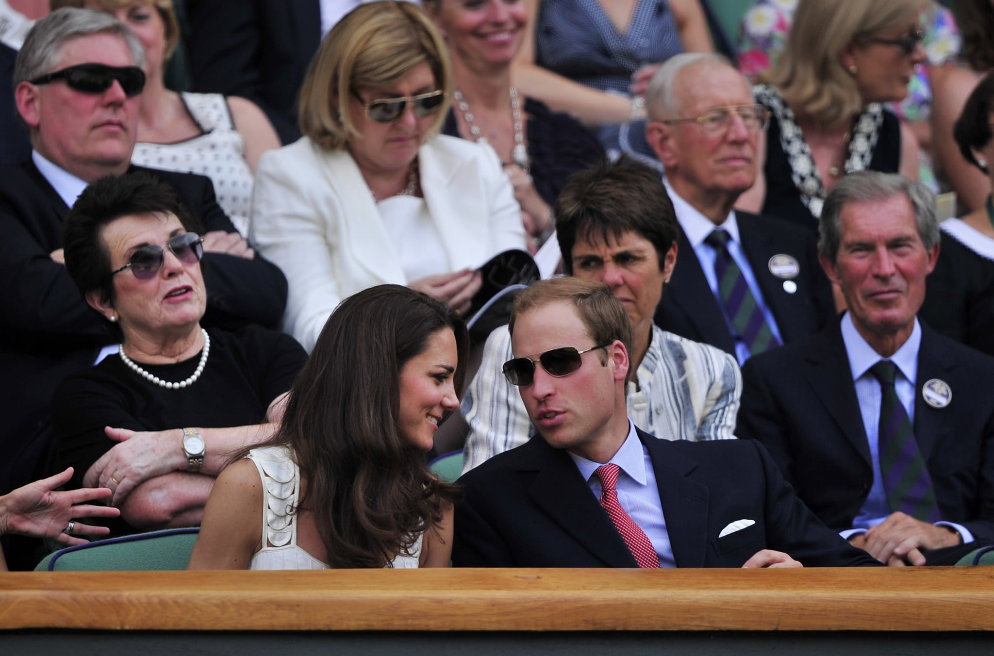 Kate smiled at Will, who looked handsome in sunglasses, as they took in a Wimbledon match in June 2011.