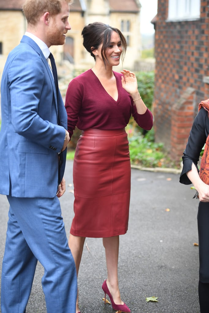 During an outing in late 2019, the Duchess paired the same leather skirt by Boss, this time in a striking burgundy, with a matching v-neck sweater and suede heels for a full cranberry-colored look.