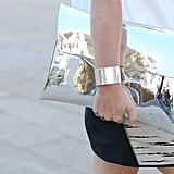 A mirrored metallic clutch mirrored a sleek cuff.