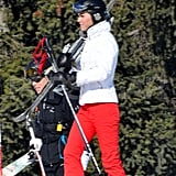 Kate Middleton with her skis on her shoulder on vacation in France.