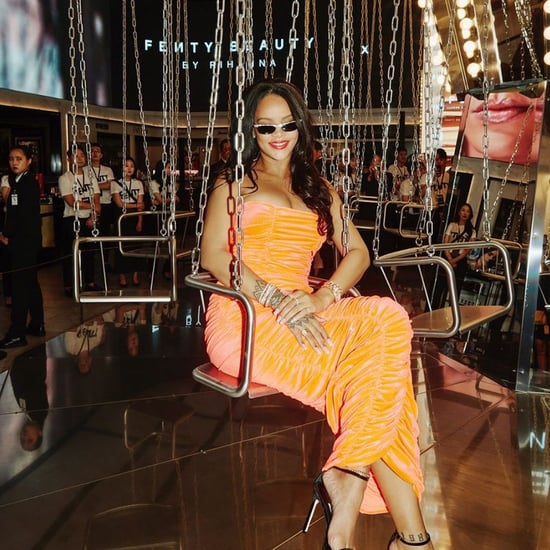 Rihanna Wearing Orange Dress While Sitting on a Carousel