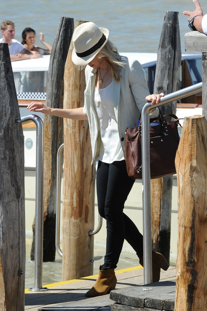 Naomi Watts wore a blazer and brown boots while getting off of a boat at the Venice Film Festival.