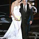 Charlize Theron hugged Dustin Hoffman at the 2013 Oscars.