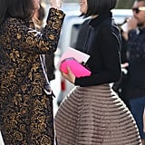 Fashionable friends showed off their statement-makers, a brocade coat and a voluminous fit-and-flare skirt, respectively.