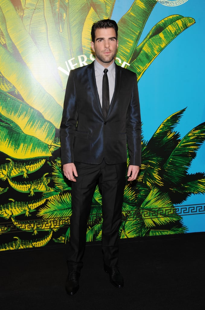 Zachary Quinto in a sleek black suit for the Versace for H&M fashion show in NYC.