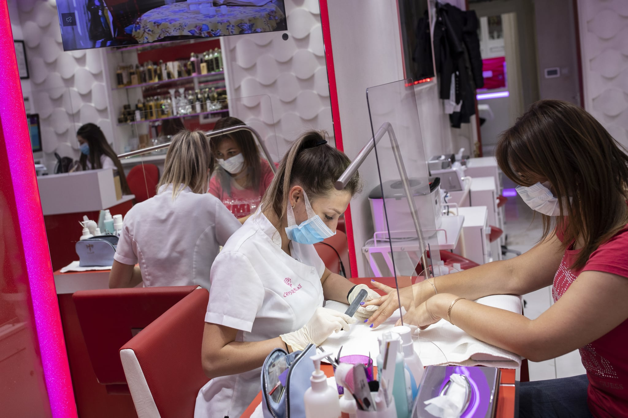 LONDON, ENGLAND - JULY 13: A customer has her nails done at the Crystal Palace Spa in Marylebone on July 13, 2020 in London, England. Nail salons, tattoo parlors and spas are among the businesses allowed to reopen today in England as the government eases the restrictions meant to curb the spread of Covid-19. (Photo by Dan Kitwood/Getty Images)